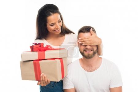 woman surprising boyfriend by gifts
