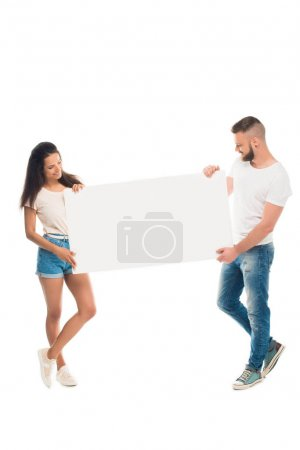 Attractive couple with blank banner
