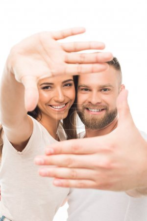 Attractive couple with hands frame