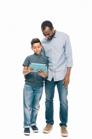 father and son with digital tablet