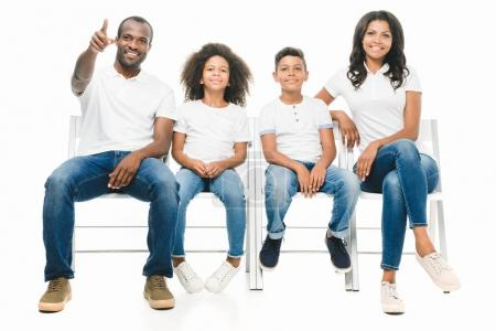 african american family sitting on chairs