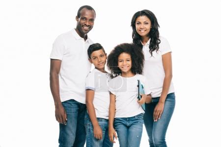 Photo for Happy african american family holding digital tablet and smiling at camera isolated on white - Royalty Free Image