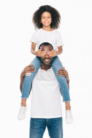 Photo for Happy african american father carrying adorable little daughter on neck isolated on white - Royalty Free Image