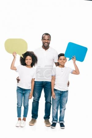 Photo for Happy african american father with cute kids holding blank speech bubbles isolated on white - Royalty Free Image