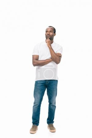 Photo for Pensive african american man holding hand on chin and looking away isolated on white - Royalty Free Image