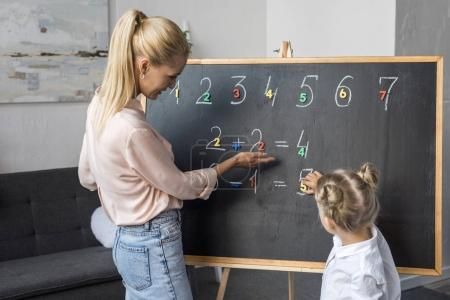 Mother and daughter learning numbers