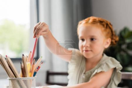 girl choosing color pencil