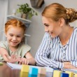 Mother and daughter learning math at home