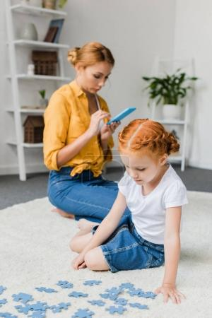 girl assembling puzzle