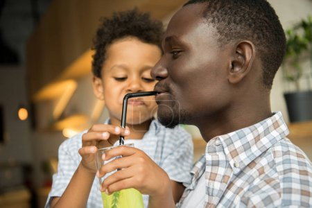 father and son drinking lemonade