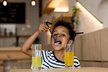 African american child drinking juice