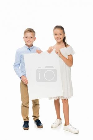 Photo for Happy siblings holding empty board, isolated on white - Royalty Free Image