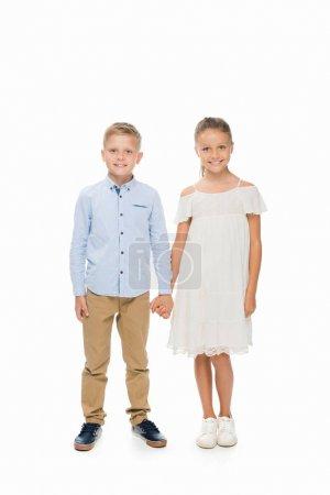 Photo pour Adorable petite amie et petit ami tenant la main, isolé sur blanc - image libre de droit