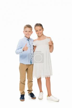siblings showing thumbs up