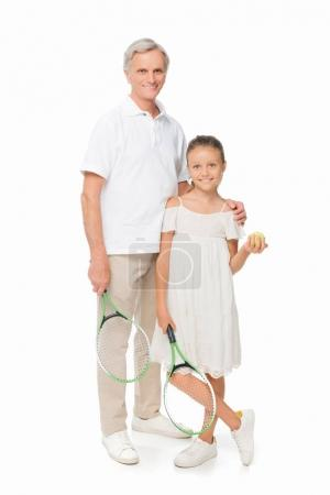 granddaughter and grandfather with tennis equipment