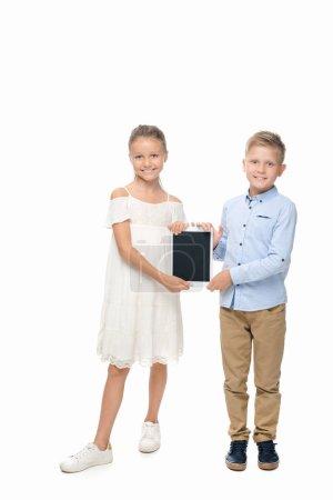 siblings with digital tablet