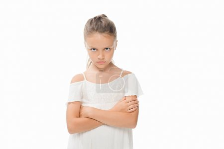 Photo for Portrait of little grumpy girl with arms crossed looking at camera isolated on white - Royalty Free Image