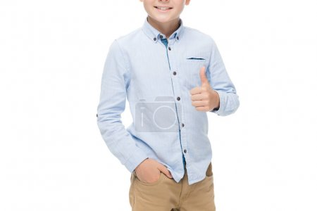 Photo for Partial view of smiling boy showing thumb up isolated on white - Royalty Free Image