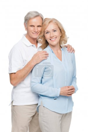 Photo for Beautiful happy mature couple embracing and smiling at camera isolated on white - Royalty Free Image