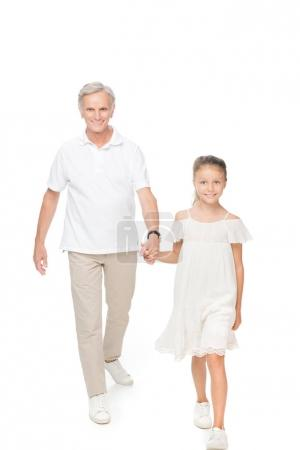 grandfather with grandchild holding hands