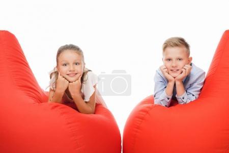 siblings on bean bag chairs