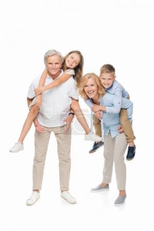 kids piggybacking on grandparents