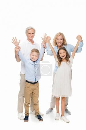 Photo for Happy grandparents and kids with raised hands isolated on white - Royalty Free Image