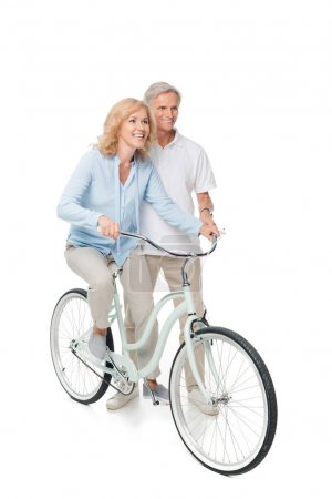 mature man and woman with bicycle