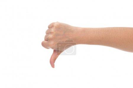 Photo pour Plan recadré de la main montrant pouce vers le bas isolé sur blanc - image libre de droit