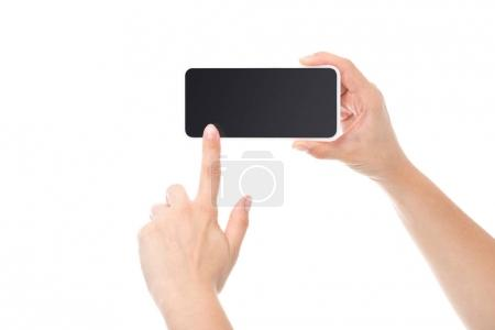 Photo for Cropped shot of person pointing at smartphone blank screen isolated on white - Royalty Free Image