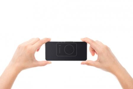 Photo for Partial view of hands holding smartphone with blank screen isolated on white - Royalty Free Image