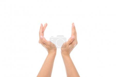 Photo pour Vue partielle des mains féminines prétendant tenir quelque chose isolé sur blanc - image libre de droit