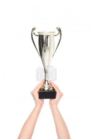 Photo for Partial view of female hands holding champion cup isolated on white - Royalty Free Image
