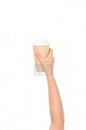 Cropped shot of disposable coffee cup in hand isol...