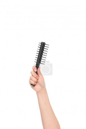 hand holding hairbrush