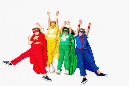 flying kids in superhero costumes
