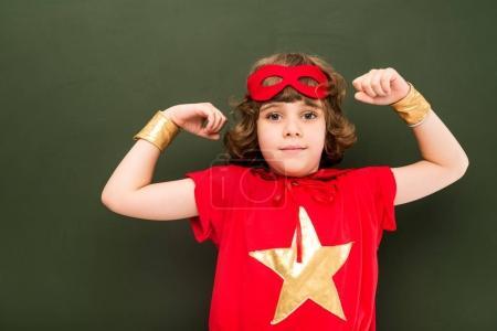 strong boy in superhero costume