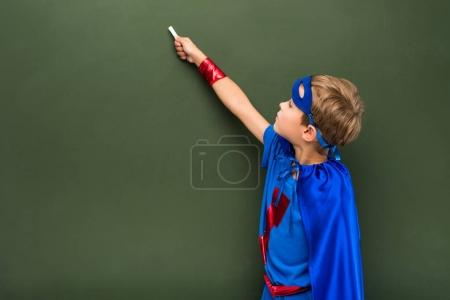schoolchild in superhero costume
