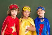 Pupils in superhero costumes