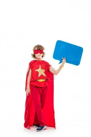Photo for Boy in superhero costume holding empty speech bubble, isolated on white - Royalty Free Image