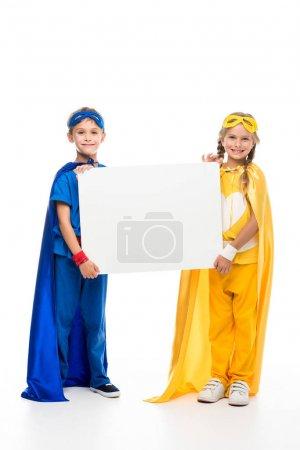 superheroes holding blank board