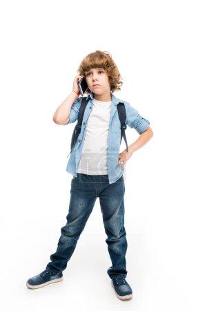 schoolboy talking on smartphone