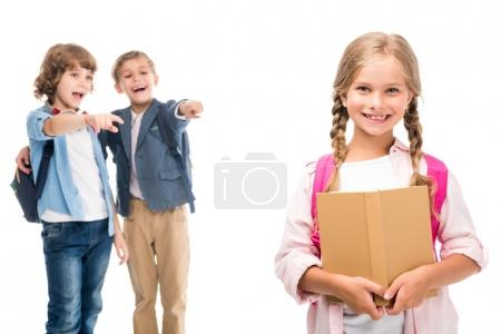 Photo for Pupils laughing at schoolgirl with book, isolated on white - Royalty Free Image
