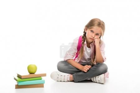 bored schoolgirl with books with apple