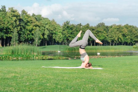 Woman performing yoga headstand pose
