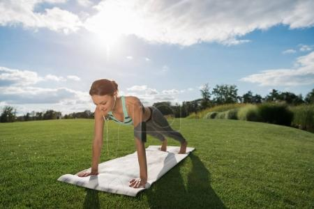 woman standing in plank
