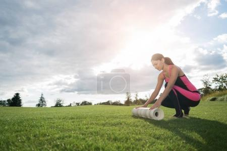 woman preparing for doing yoga