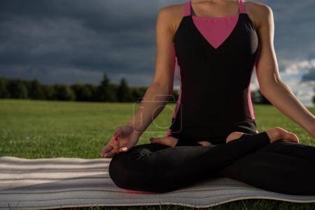 woman performing lotus pose