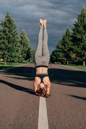 athletic woman practicing yoga