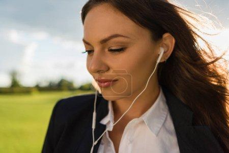 businesswoman in earphones